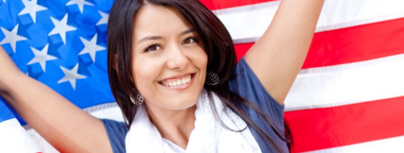 Latina woman holding an American flag